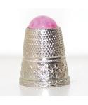 Metalowy z różowym oczkiem